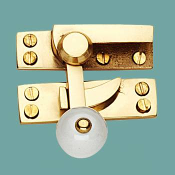 <PRE>Traditional Window Sash Lock Solid Brass Porcelain Knob </PRE>