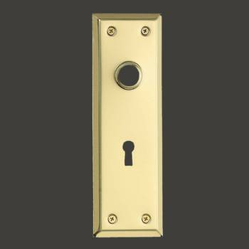 <PRE>Door Back Plate Bright Solid Brass Stamped w/Keyhole 7 3/4&quot; </PRE>